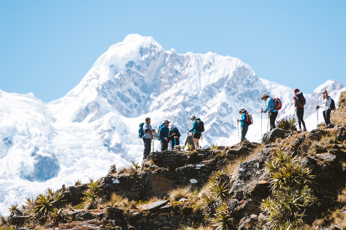 trekkers on choquequirao to machu picchu trek with snow capped mountain behind