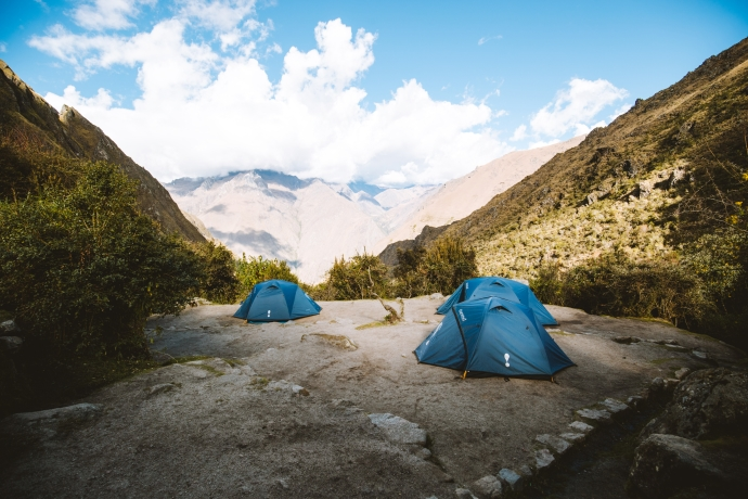 blue Eureka tents at empty campsite on 5 day inca trail