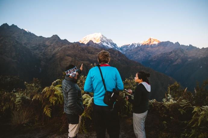 trekkers watching sunrise at Phuyupatamarca, Inca Trail