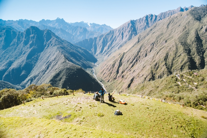 trekkers relaxing at Machu Picchu