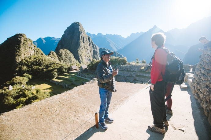 guide and clients at machu picchu