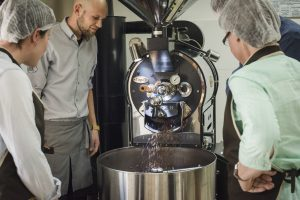 clients taking a bean to barista experience in cusco´s museo de cafe