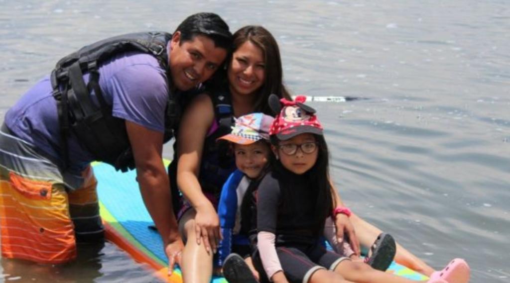 kids paddleboarding in peru