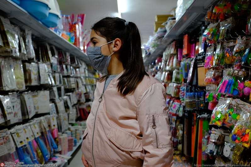 woman shopping wearing a mask in the pandemic
